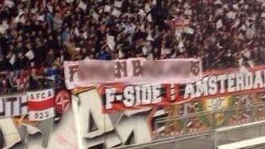Ajax fans unfurl an offensive banner during Ajax v Celtic.