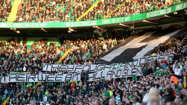 Celtic fans unfurl a banner during their game with Aberdeen.
