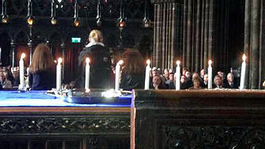 Eight candles at memorial service in Glasgow Cathedral for victims of Clutha helicopter tragedy.