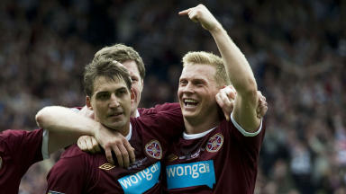 Hearts' Rudi Skacel (centre) is hailed by team-mates Stephen Elliott (left) and Andrew Driver after scoring his side's fifth goal of the game