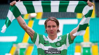 New Celtic signing Stefan Johansen is all smiles after arriving in Glasgow from Norwegian side Stromsgodset.