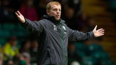 Celtic manager Neil Lennon looks on from the dugout.