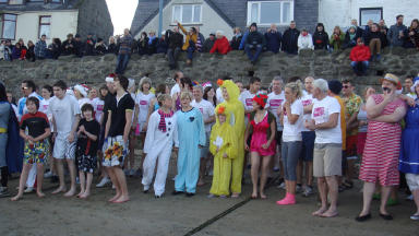 Charity: Nippy Dippers prepare to run into the chilly North Sea.