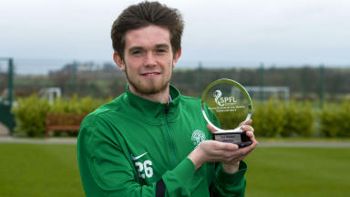 Hibernian's Sam Stanton with the Young Player of the Month award for February.