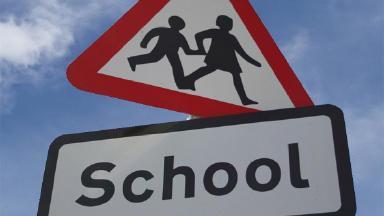 School crossing sign.