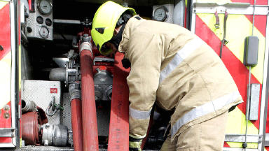 Anonymous firefighter at fire engine fire tender good generic quality image