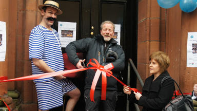 Historic moment: Peter Mullan cuts the ribbon to open the Govanhill Baths
