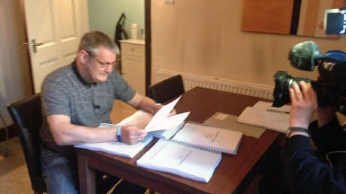Mortonhall baby ashes scandal parent Willie Reid reads report on 30 April 2014.