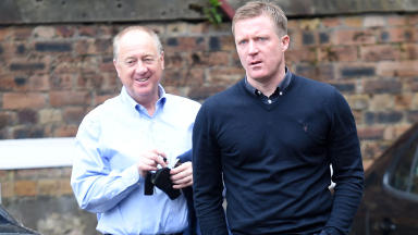 Leaving: Gary Locke (right) arrives at Tynecastle with Billy Brown on Monday morning