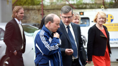 Team: Robbie Neilson, left, walks into Tynecastle with Craig Levein (foreground) and Ann Budge, (right).