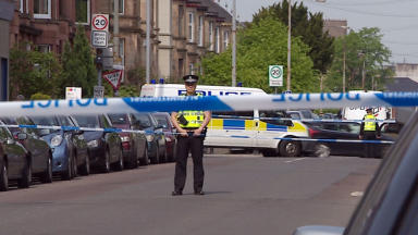 Police at the scene of rape investigation in  Dixon Avenue in the Govanhill area of Glasgow May 19 2014