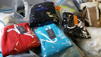 Haul: Clothes, footwear and electrical goods seized at trader's home address.