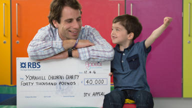 Mark Beaumont delivers cheque to Yorkhill Sick Kids Hospital on behalf of the STV Appeal.