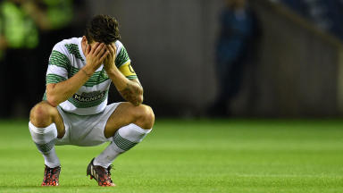 Celtic captain Charlie Mulgrew hangs his head at the final whistle against Legia Warsaw.