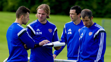 Workload: Robbie Neilson on the training field at Riccarton with sport scientist John Hill and coaching team.