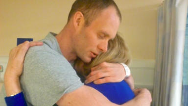 David Smith: Athlete embraces mother after surgery.