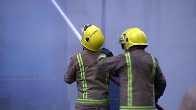 Probe: Flats evacuated while firefighters tackled wilful blaze.