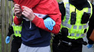 Raids: Drugs and cash seized by police.