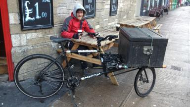 James Tait on his bike delivering soup