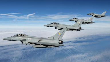 Typhoons: RAF jets escort fighters away from UK.