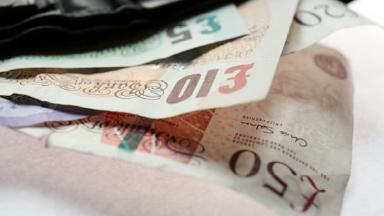 Banknotes: The men are accused of distributing counterfeit money.