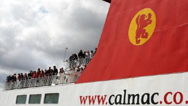 Crowds onboard a Calmac ferry watch as Britain's Queen Elizabeth II and members of the Royal family board the Hebridean Princess , as they begin a holiday around the Western Isles. Picture date: Friday, July 23, 2010. Photo credit should read: PA image Uploaded April 27 2015