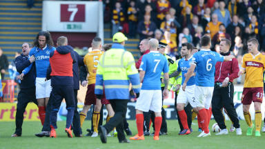 Rangers' Bilel Mohsni (left) is removed from the field of play