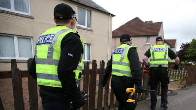 Police raid police scotland serious and organised crime Cowdenbeath Fife quality news image uploaded June 20 2015 NB: faces not visible