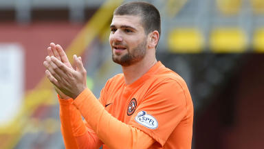Dundee United's Nadir Ciftci applauds the fans at full-time