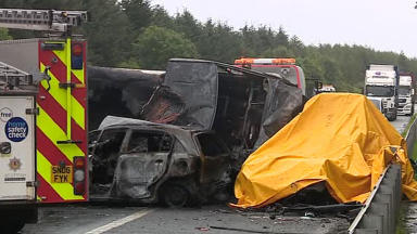 Crash: Aftermath of smash on M8 in which Wayne Strickland died.