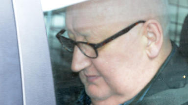 Harry Clarke: Driver at wheel in bin lorry which crashed at George Square.