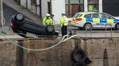 Harbour plunge: The woman was pulled from sinking car.