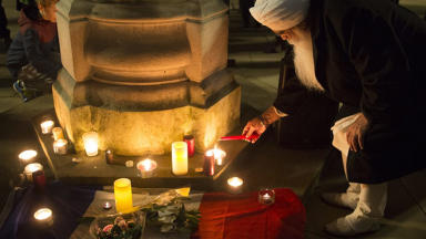 People attend a candle lit vigil in St Phillips Square in Birmingham, to remember those who were killed and injured during the terror attacks in Paris on Friday evening. Quality news iamnge uploaded November 15 2015.