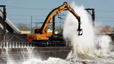 Scheduled work to strengthen sea defences in Saltcoats, Scotland, as Storm Abigail hits the UK. Uploaded from PA November 17 2015