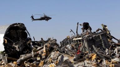 A helicopter flies over debris a day after the crash on October 31.