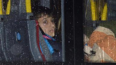 Glasgow arrival: Syrian refugee child on bus to new home.