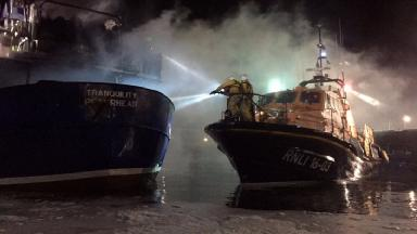Peterhead Harbour: Firefighters battle boat blaze.