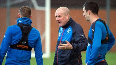 Mark Warburton talks to his Rangers players during training.