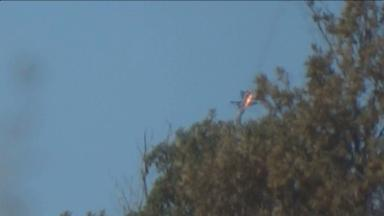 The jet can be seen falling to the ground.
