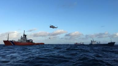 Rescue: Cargo freighter Skog (far right) got into difficulty.