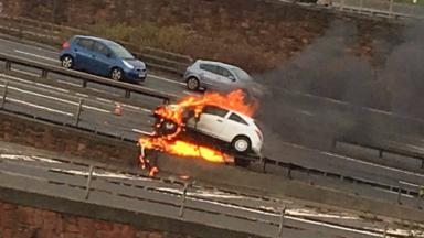 Vauxhall Corsa: One person rushed to hospital after car burst into flames.