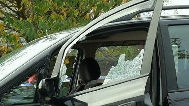 The smashed window of the vehicle.