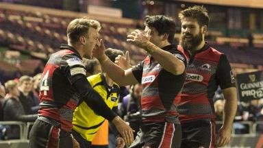 Delight: Tom Brown celebrates a decisive score at Murrayfield