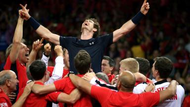 Great Britain's Andy Murray is mobbed by his team-mates after winning the Davis Cup.
