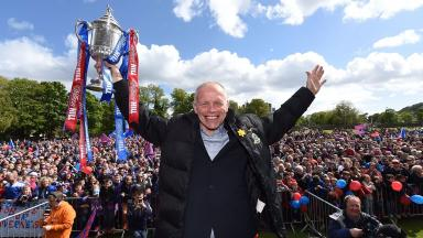 John Hughes lifted the Scottish Cup in May.