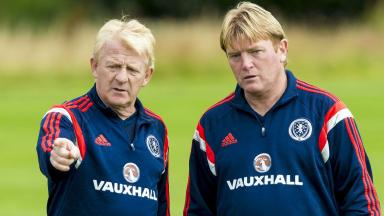 Is the end near? Stuart McCall (right) works with Scotland boss Gordon Strachan on the training ground.