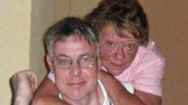 Unexplained death: Ian MacDonald with partner Kathleen Cook.