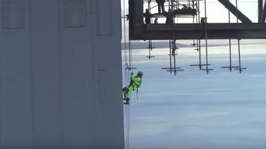 Drone: Footage captures workers carrying out repairs on closed bridge.