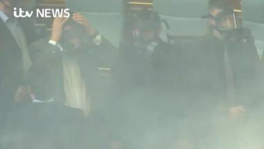 The latest unruly action by the Kosovo opposition saw the debating chamber cleared in Pristina after smoke filled the room.