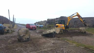 Cove Bay: Harbour blocked off with boulders.